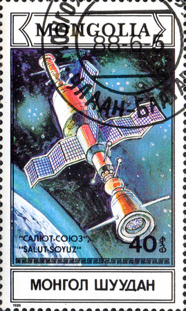postmark: UKRAINE - CIRCA 2017: A postage stamp printed in Mongolia shows Docking in space of spacecraft Soyuz and Salut from series Space research, circa 1988