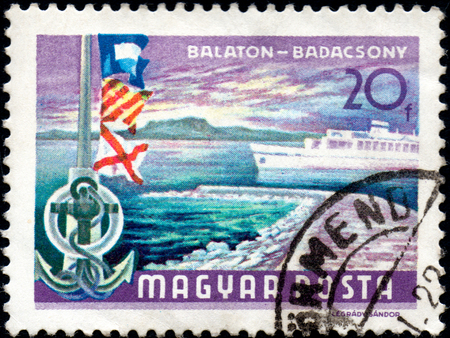 postmark: UKRAINE - CIRCA 2017: A postage stamp printed in Hungary shows Lake Balaton at Badacsony, circa 1968
