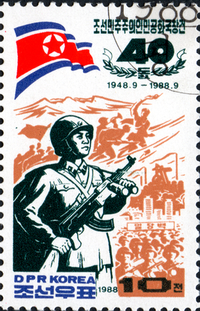 UKRAINE - CIRCA 2017: A postage stamp printed in North Korea shows Paektu mountain, guerilla fighter, from series The 40th Anniversary of Democratic Republic of Korea, circa 1988 Éditoriale
