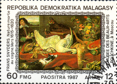 UKRAINE - CIRCA 2017: A postage stamp printed in Madagascar shows Frans Snyders: Still Life with Swan 1615-1620, from series Paintings from Pushkin-Museum, Moscow, circa 1987