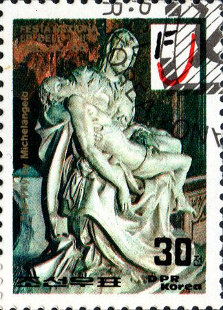 UKRAINE - CIRCA 2017: A postage stamp printed in North Korea shows Michelangelos Pity, from series The Unita Festival, Milan, circa 1986
