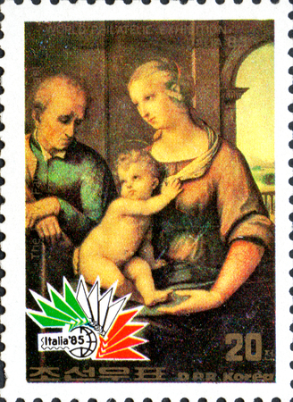 UKRAINE - CIRCA 2017: A postage stamp printed in North Korea shows The holy family, by Raphael, from series International Stamp Exhibition ITALIA 85, circa 1985 Éditoriale
