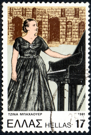 UKRAINE - CIRCA 2017: A postage stamp printed in Greece shows Gina Bachauer 1913-1976, Greek classical pianist, from series Anniversaries and Events, circa 1981