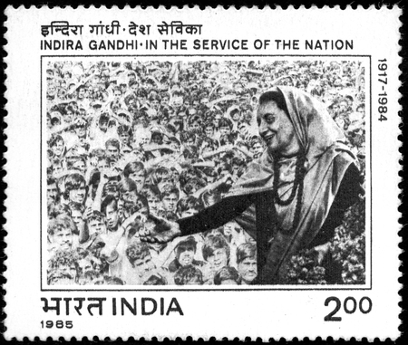 UKRAINE - CIRCA 2017: A postage stamp printed in India shows Indira Gandhi In the Service of the Nation. Series: Commemorations, circa 1985 Éditoriale