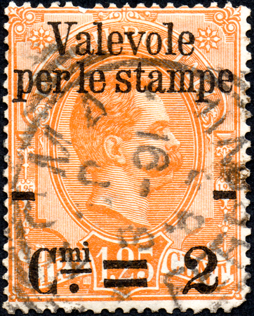 UKRAINE - CIRCA 2017: A postage stamp printed in Italy shows Portrait of a Man and inscription Post parcels, from series Parcel Stamps, circa 1884