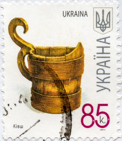 UKRAINE - CIRCA 2017: A postage stamp printed in Ukraine shows Large Vessel for Liquids Bucket, circa 2007 Éditoriale