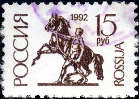 UKRAINE - CIRCA 2017: A postage stamp printed in Russia shows The Horse-tamer statue, St. Petersburg. Series 1st Definitive Issue, circa 1992