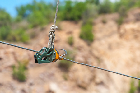 Ukraine, Migea - July 30, 2017: Close-up Automatic brake unit Head Rush Zip Stop for high-speed lines Zipline and for trolley lines. Equipment for safe trolling on a steel cable. Zipline. Éditoriale