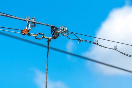 Equipment for safe trolling on a steel cable. Zipline. Stock Photo