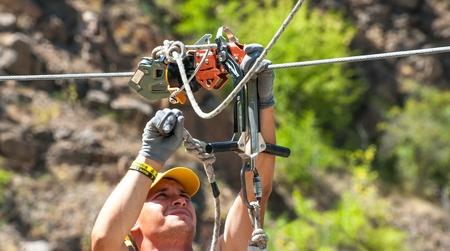 Ukraine, Migea - July 30, 2017: Automatic brake unit Head Rush Zip Stop for high-speed lines Zipline and for trolley lines. Equipment for safe trolling on a steel cable. Roller for high-speed zipline.