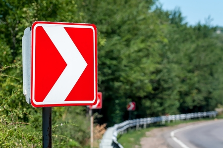 Right Turn Sign. Road signs warn of a sharp turn. Banque d'images