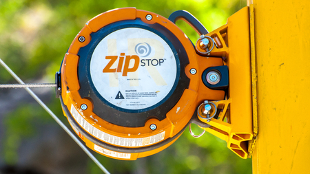 Ukraine, Migea - July 30, 2017: Close-up Automatic brake unit Head Rush Zip Stop for high-speed lines Zipline and for trolley lines. Equipment for safe trolling on a steel cable. Zipline. Editorial