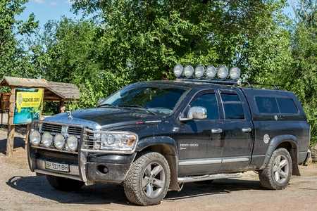 Ukraine, Migea - July 30, 2017: American Off-road vehicle pickup truck Dodge Ram 1500 5.7 L Performance in the parking lot