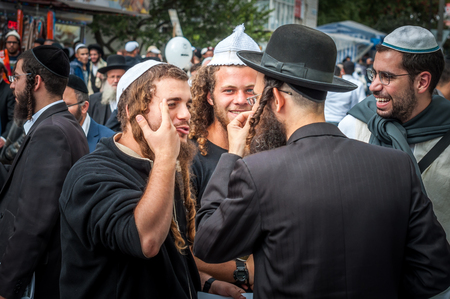 Uman, Ukraine - 2 October 2016: Rosh Hashanah, Jewish New Year 5777. It is celebrated at the grave of Rabbi Nachman. Pilgrims of Hasidim in traditional festive attire celebrate mass on the Uman. Éditoriale