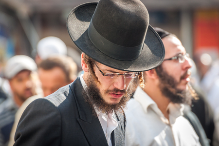 hasidic: Uman, Ukraine - 2 October 2016: Rosh Hashanah, Jewish New Year 5777. It is celebrated at the grave of Rabbi Nachman. Pilgrims of Hasidim in traditional festive attire celebrate mass on the Uman. Editorial