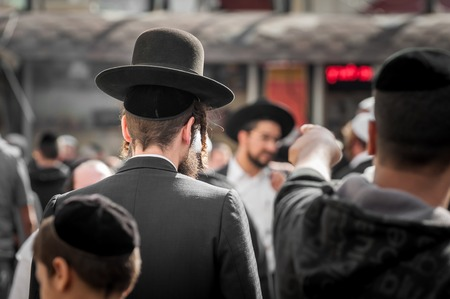 kippah: The Jewish Hasid in traditional clothes with long payos. Editorial