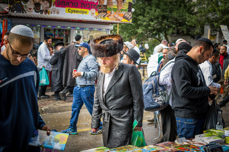 Uman, Ukraine - 2 October 2016: Rosh Hashanah, Jewish New Year 5777. It is celebrated at the grave of Rabbi Nachman. Pilgrims of Hasidim in traditional festive attire celebrate mass on the Uman. Editorial