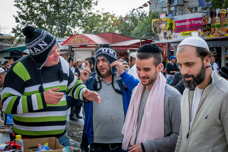 kippah: Uman, Ukraine - 2 October 2016: Rosh Hashanah, Jewish New Year 5777. Pilgrims of Hasidim in traditional festive attire celebrate mass on the Uman. Sellers of souvenirs. Editorial