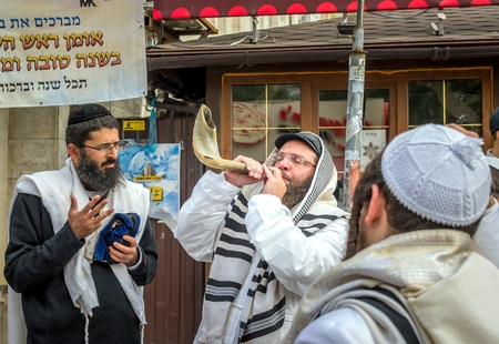 Uman, Ukraine - 21 September 2017: Rosh Hashanah, Jewish New Year 5778. It is celebrated near the grave of Rabbi Nachman in Uman. Jewish hasid blows Shofar.