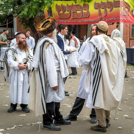 Uman, Ukraine - 21 September 2017: Rosh Hashanah, Jewish New Year 5778. It is celebrated near the grave of Rabbi Nachman. Pilgrims of the Hasidim on the street of the city of Uman. Editorial