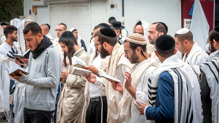 Prayer. Uman, Ukraine - 21 September 2017: Rosh Hashanah, Jewish New Year. It is celebrated near the grave of Rabbi Nachman. Pilgrims Hasidim on the street of the city of Uman. Éditoriale