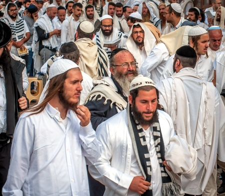 Mass prayer. Hasids pilgrims in traditional clothes. Uman, Ukraine - September 21, 2017: Rosh-ha-Shana festival, Jewish New Year. Publikacyjne