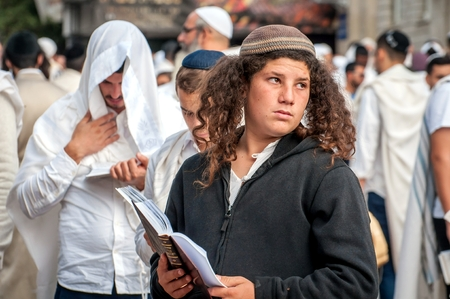 Young hasid pilgrim in the crowd on the city street. Uman, Ukraine - 21 September 2017: holiday Rosh Hashanah, Jewish New Year.