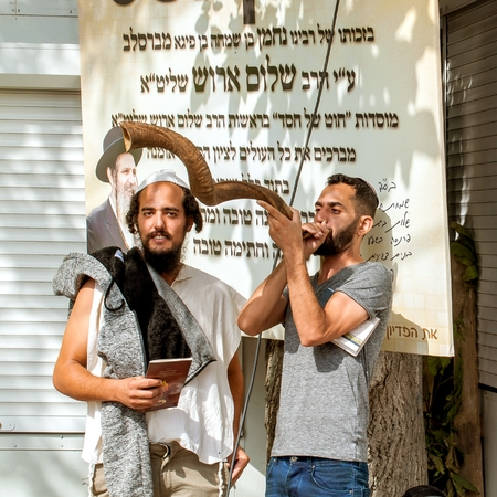 Jewish hasid blows Shofar. Uman, Ukraine - 21 September 2017: Rosh Hashanah, Jewish New Year. Editorial