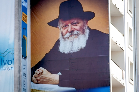 A large banner on a multi-storey building. Portrait of Tsadik Nachman. Uman, Ukraine - 21 September 2017: Rosh Hashanah, Jewish New Year. Editorial