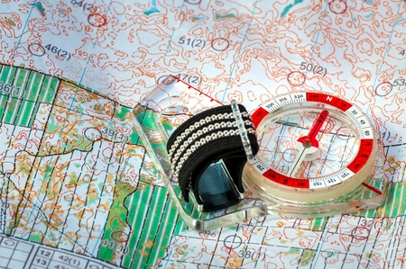 Orienteering. Compass and topographic map. Navigation equipment for orienteering. The concept.