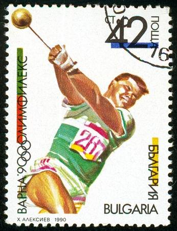 UKRAINE - circa 2017: A postage stamp printed in Bulgaria shows Hammer Throw, OLYMPHILEX 90, Varna, serie International Stamp Exhibition, circa 1990 Editorial
