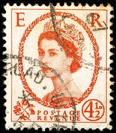 Ukraine - circa 2017: A postage stamp printed in United Kingdom shows picture portrait Queen Elizabeth II, circa 1959 Editorial
