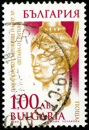 Ukraine - circa 2018: A postage stamp printed in Bulgaria shows drawing Head as a Pot Belly. Series: Thracian gold treasure of Panagurishte. Circa 1999.