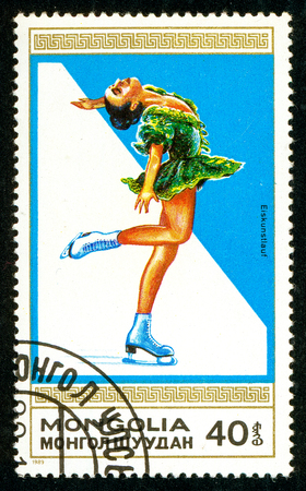 Ukraine - circa 2018: A postage stamp printed in Mongolia shows drawing Woman Figure Skating. Series: Winter sports. Circa 1989.