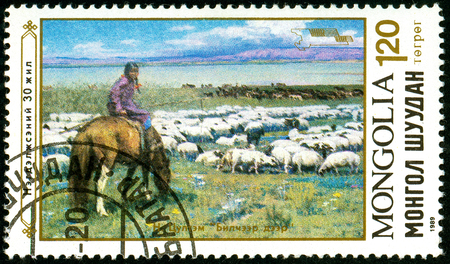 Ukraine - circa 2018: A postage stamp printed in Mongolia shows Sheep, shepherd girl on horse. Series: Paintings. Circa 1989.