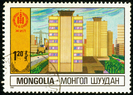 Ukraine - circa 2018: A postage stamp printed in Mongolia shows Multi-storey residential buildings. Public housing. Series: 60 Years of Independence. Circa 1981 Éditoriale