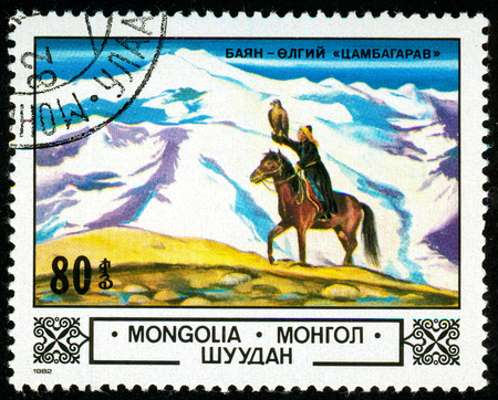 Ukraine - circa 2018: A postage stamp printed in Mongolia shows Falcon hunting. A rider on a horse holds a falcon on his hand. Series: Animals and landscapes. Series: Flora. Circa 1982. Éditoriale