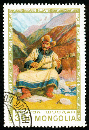Ukraine - circa 2018: A postage stamp printed in Mongolia shows Man playing lute. Series: Mongolian paintings masterfully. Circa 1975.