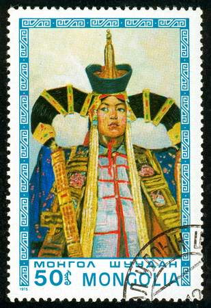 Ukraine - circa 2018: A postage stamp printed in Mongolia shows A man in colorful, festive, solemn national Mongolian clothes. Fixed Garment. Series: Mongolian paintings masterfully. Circa 1975.