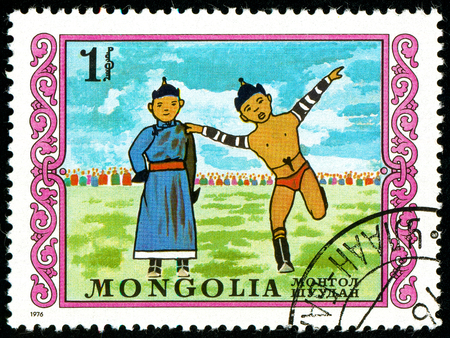Ukraine - circa 2018: A postage stamp printed in Mongolia shows Mongolian wrestling. Series: International Childrens Day. Circa 1976. Sajtókép