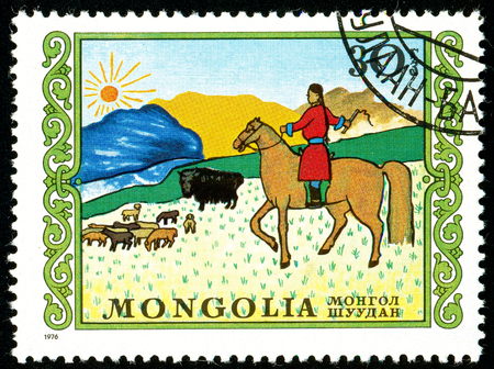 Ukraine - circa 2018: A postage stamp printed in Mongolia shows Herding. A shepherd is looking after a herd of sheep on horseback. Series: International Childrens Day. Circa 1976. Éditoriale