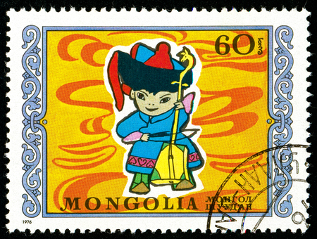 Ukraine - circa 2018: A postage stamp printed in Mongolia shows Young musician. Series: International Childrens Day. Circa 1976. Éditoriale