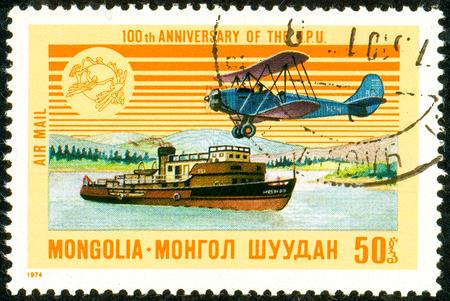 Ukraine - circa 2018: A postage stamp printed in Mongolia shows Airplane, Steamship. Series: U.P.U. Universal Postal Union, Centenary. Circa 1974. Éditoriale