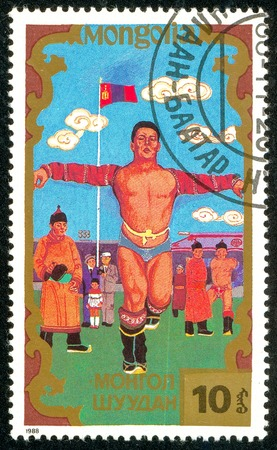 Ukraine - circa 2018: A postage stamp printed in Mongolia shows Traditional Mongolian sport. Series: Sports. Circa 1988. Éditoriale