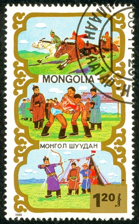 Ukraine - circa 2018: A postage stamp printed in Mongolia shows Horsemanship, Wrestling, Archery, bow, arrows, weapons - Traditional Mongolian sport. Series: Sports. Circa 1988.