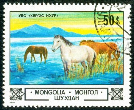 Ukraine - circa 2018: A postage stamp printed in Mongolia show Horse or Equus ferus caballus at Uvs Lake. Series: Animals and landscapes. Circa 1982.