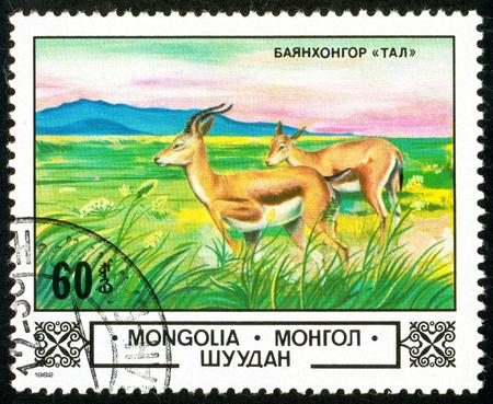 Ukraine - circa 2018: A postage stamp printed in Mongolia show Goitered Gazelle or Gazella subgutturosa in Bajanchongor Step. Series: Animals and landscapes. Circa 1982.