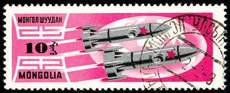 Ukraine - circa 2018: A postage stamp printed in Mongolia show Rockets Wostok 5 and 6. Series: Exploration of the universe. Circa 1964.