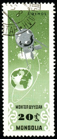 Ukraine - circa 2018: A postage stamp printed in Mongolia show Artificial earth satellite. Series: Exploration of the universe. Circa 1964. Éditoriale
