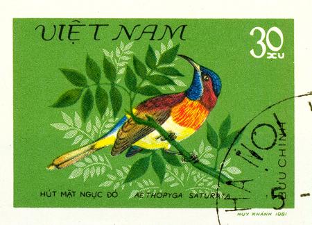 Ukraine - circa 2018: A postage stamp printed in Vietnam show Black-throated Sunbird or Aethopyga saturata. Series: Birds. Circa 1981. Éditoriale